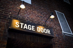 Stage door at London theatre illuminated by spotlights. Illuminated sign at theatre in London's West End Royalty Free Stock Photos