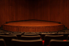 Stage & empty chairs Royalty Free Stock Photos
