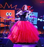 On stage, the expressive red-haired violinist Maria Bessonova Royalty Free Stock Photography