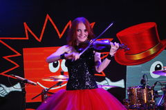 On stage, the expressive red-haired violinist Maria Bessonova Royalty Free Stock Photos