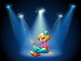 A stage with a female clown sitting at the center Stock Images