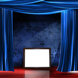 Stage frame. A frame sitting on a stage with a red floor, blue curtains and a textured wall backdrop stock image