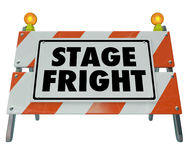 Stage Fright Fear Public Speaking Performance Sign Barricade. Stage Fright words on a barricade or sign to illustrate a fear of public speaking or performance Stock Photo