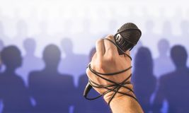 Stage fright in public speaking or bad karaoke singing live. In front of crowd of people. Problem with speech or failed talent show performance. Microphone wire Royalty Free Stock Image