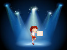 A stage with a girl holding an empty signage in the middle Stock Photo