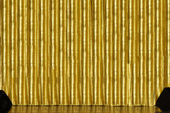 Stage with golden curtain. A stage with golden curtain and spakers Stock Images