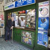 Maida Vale Station. News vendor with friend at Maida Vale station Royalty Free Stock Photography