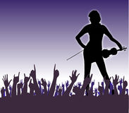 On Stage. Hands raised in the air at a concert to a female fiddle player Royalty Free Stock Photos