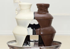 Stage from hot white and black chocolate. Close up Royalty Free Stock Images