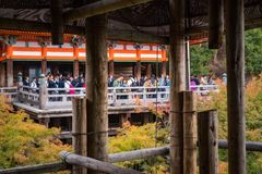 The Stage of Kiyomizu in Kyoto, Japan. Gion, Kyoto, Japan -November 2, 2018: People at the terrace of the famous Kiyomizu-dera Buddhist Temple. Its veranda is stock images