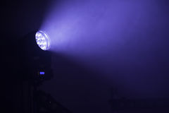 Stage LED spot light with blue beam Stock Photo