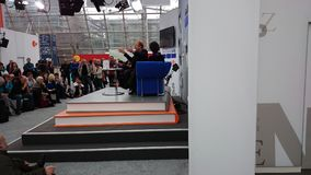 Stage of the Leipzig book fair with a couch and many visitors. stock photo