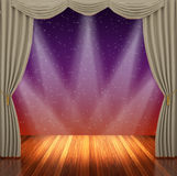 Stage with light brown  curtains and spotlight. Stock Photo