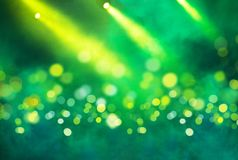 Stage light projector and yellow glitter lights Royalty Free Stock Photo