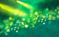 Stage light projector and yellow glitter lights Royalty Free Stock Images