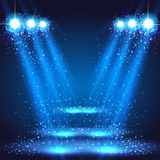 Stage, light, spotlights shining in dark place background Stock Images