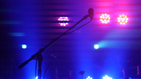Stage lighting, equipment, beam and microphone stand in a night club Stock Photography