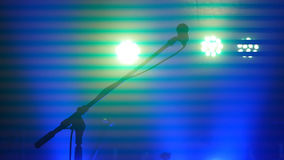Stage lighting, equipment, beam and microphone stand in a night club Royalty Free Stock Image