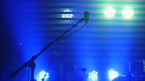 Stage lighting, equipment, beam and microphone stand in a night club Stock Image