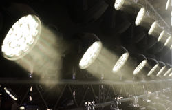 Stage lighting equipment. Modern Concert spotlight. The direct rays of light in the haze royalty free stock photography