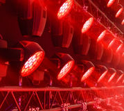 Stage lighting equipment. Modern Concert spotlight. The direct rays of light in the haze stock photography