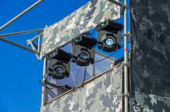 Stage lighting. Rotating electrical stage lighting devices located on the street scene royalty free stock image