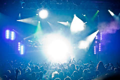 Stage lights. A pop rock concert scene with crowd in the foregorund Royalty Free Stock Image