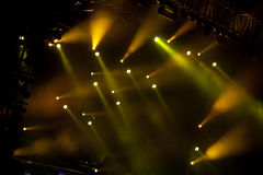 Stage lights. Image of yellow stage lights, thick fog creates drama stock photos