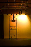 Stage lights. Man on scaffolding fixing the stage lights, preparing for the show stock photo