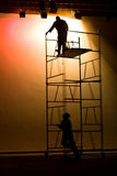 Stage lights. Man on scaffolding fixing the stage lights, preparing for the show stock images