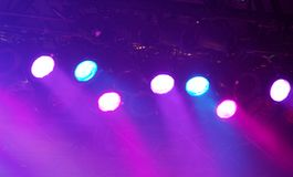 Stage Lights. Multicolored stage spot lights and fog Royalty Free Stock Photo
