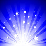 Stage lights. With stars on blue background Royalty Free Stock Image