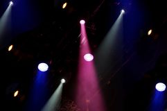 Stage lights. Large group of bright stage lights shining down royalty free stock images