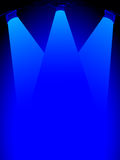 Stage lights. On top with blue background Royalty Free Stock Photography