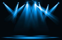 Stage lights. Blue spotlight strike through the darkness. stock illustration