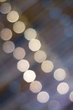 Stage lights. Blurry stage lights with light tones Royalty Free Stock Images