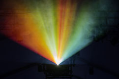 Stage Lights. Colored stage lights illuminate fog in a rainbow stock photos