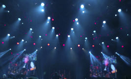 Stage lights in a concert. Of different colors. Blurred blue background Stock Photo