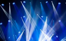 Stage lights on concert. Lighting equipment. With blue colored beams Stock Image