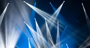 Stage lights on concert. Lighting equipment. With multi-colored beams Stock Photos