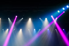 Stage lights on concert. Lighting equipment with multi-colored beams Royalty Free Stock Photos