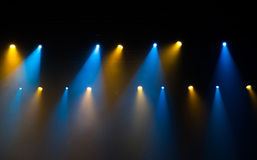 Stage lights on concert. Lighting equipment with multi-colored beams Stock Photo