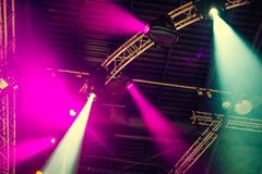 Stage lights on concert. Lighting equipment with multi-colored beams. Bottom view. Selective focus. Copy space stock photo