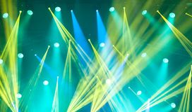 Stage lights on concert. Lighting equipment. With multi-colored beams Stock Photo