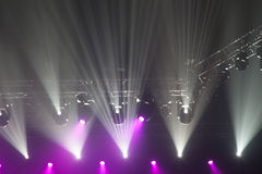 Stage lights on concert. Lighting equipment with multicolored beams Royalty Free Stock Photos