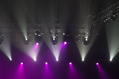 Stage lights on concert. Lighting equipment with multicolored beams Royalty Free Stock Image