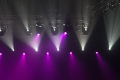 Stage lights on concert. Lighting equipment with multicolored beams Royalty Free Stock Photo