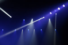 Stage lights on concert. Lighting equipment with multicolored beams Stock Photo