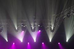 Stage lights on concert. Lighting equipment with multicolored beams Royalty Free Stock Images