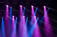 Stage lights on concert. Lighting equipment with multicolored beams stock image